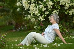 Older woman sitting Royalty Free Stock Images