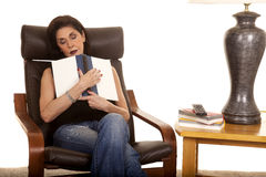 Older woman sleep with book in chair Stock Image