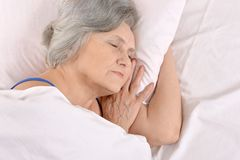 Older woman sleeping in the bedroom Royalty Free Stock Photo