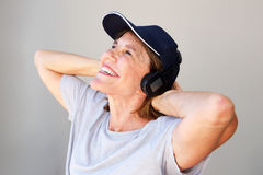 Older woman smiling with headphones Royalty Free Stock Photos