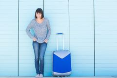 Older woman smiling with suitcase Royalty Free Stock Photos