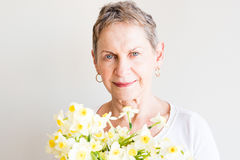 Older woman with spring flowers Royalty Free Stock Photo