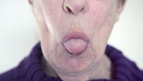 Older woman sticking out her tongue Royalty Free Stock Photo