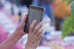 Older woman with tablet Royalty Free Stock Photos