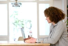 Older woman using laptop at home Stock Image