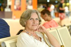 Older woman in the waiting room Royalty Free Stock Photo