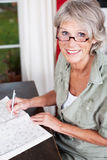 Older woman wearing glasses working Stock Photos
