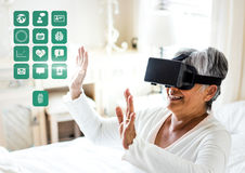 Older Woman wearing VR Virtual Reality Headset with Health Medical Interface. Digital composite of Older Woman wearing VR Virtual Reality Headset with Health stock image