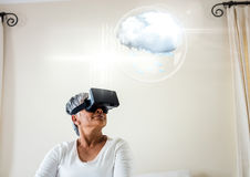 Older Woman wearing VR Virtual Reality Headset with Interface Royalty Free Stock Photo