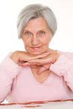 Older woman on a white. Beautiful older woman on a white background Royalty Free Stock Image
