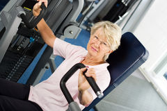 Older woman working out. At the gym Royalty Free Stock Photos