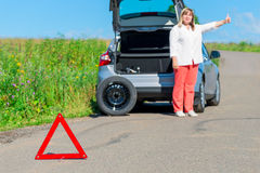 Older women asked for help on the road. Older woman asked for help on the road near the broken car Stock Photography
