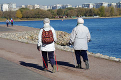 Older women with Nordic walking sticks walking in the park Kolom Stock Photos