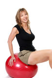 Older women sitting on excerise ball Stock Photos