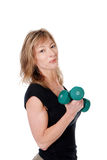 Older women with two dumbbells. Isolated older women with two dumbbells on a white background Royalty Free Stock Photo