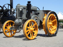 Older yellow grey tractor, fro Stock Images