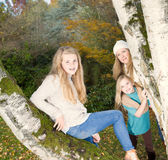 Oldest Daughter posing with mom and younger sister looking on Stock Image