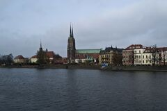 The oldest part of Wroclaw, Ostrow Tumski (Cathedral island), seen from the other side of Oder river. Stock Photography