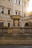 Oldest roman fountain in front of  Basilica of our lady, Rome, Italy Royalty Free Stock Photography
