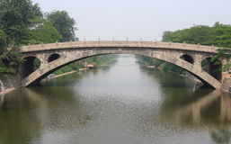 The oldest stone-arched bridge Stock Images