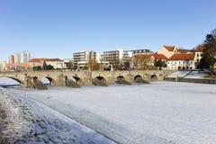 The oldest stone winter Bridge in central Europe above frozen River Otava, Pisek, Czech Republic Stock Images
