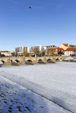 The oldest stone winter Bridge in central Europe above frozen River Otava, Pisek, Czech Republic Royalty Free Stock Photo