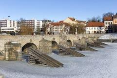 The oldest stone winter Bridge in central Europe above frozen River Otava, Pisek, Czech Republic Stock Photography