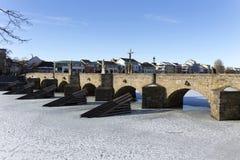 The oldest stone winter Bridge in central Europe above frozen River Otava, Pisek, Czech Republic Royalty Free Stock Image