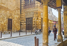 The oldest street in Cairo. CAIRO, EGYPT - OCTOBER 12, 2014: The stone walls of the medieval Qalawun complex  on the oldest street in town - Al-Muizz, on October Stock Photos