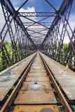 Oldest Truss railway bridge in perspective. A very smart lightweight lattice truss frame, in this long railway bridge. This metallic  railway bridge was built Stock Images