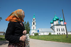 The oldest woman - a parishioner of the church after the service. Levashovo village, Yaroslavl Region, Russia - May 27, 2015: The oldest woman - a parishioner of stock images
