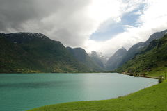 Oldevatnet lake, Norway. Calm evening, Briksdalbreen hidden in haze Royalty Free Stock Photo