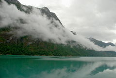 Oldevatnet lake, Norway. Calm evening, Briksdalbreen hidden in haze Stock Image