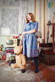 Oldfashion girl with teddy bear Royalty Free Stock Photography