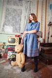 Oldfashion girl with teddy bear Stock Photography