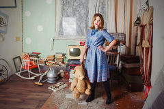 Oldfashion girl with teddy bear Stock Image
