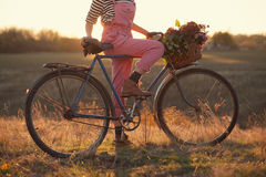 Oldfashioned girl and bike Royalty Free Stock Photography