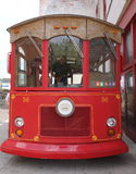 Oldfashioned red trolley bus front on. This is a picture of a trolley taken from the front only, highlighting the old wooden features of this oldfashioned bus Royalty Free Stock Photos