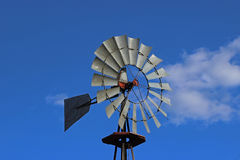 Oldfashioned Windmill against blue sky Stock Image