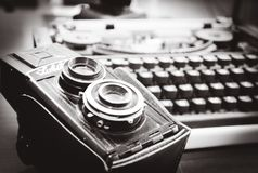 Oldie but a goldie. Old camera and a typewriter Stock Photos