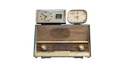 Oldie radios and clock on white background Royalty Free Stock Photo
