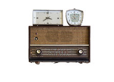 Oldie radios and clock. On white background Royalty Free Stock Photo