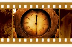 Oldies 35mm frame photo with vintage clock Stock Photos