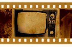 Oldies 35mm frame photo with vintage TV. Old 35mm frame photo with vintage TV Stock Photo
