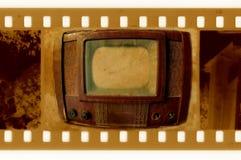 Oldies 35mm frame photo with vintage TV. Old 35mm frame photo with vintage TV royalty free stock photos