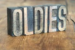Oldies word wood. Oldies word made from wooden letterpress type on grunge wood Stock Photo