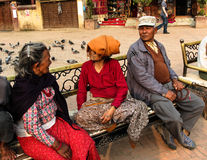 Oldman Nepalis communicate Boudhanath stupa. Boudhanath, Dec 2, 2013 in Kathmandu, Nepal. Ancient Stupa is one of the largest in the world, of 1979 is a UNESCO Royalty Free Stock Photography