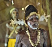 Oldman from the tribe of Asmat people. YOUW VILLAGE, ATSY DISTRICT, ASMAT REGION, IRIAN JAYA, NEW GUINEA, INDONESIA - MAY 23, 2016: Portrait of a man from the Royalty Free Stock Photo