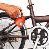 Oldman use oiler to chain of bycicle. Royalty Free Stock Image
