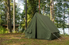 Oldschool soviet tent in nothern forest Stock Images
